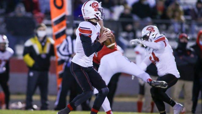 Monroe quarterback Jacob Blosser looks for a receiver against Bedford.