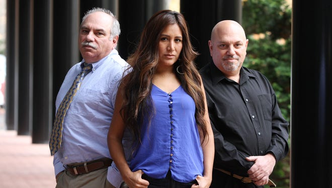 Fred Gentile, Rosa Davis and Peter Gentile of Jersey Shore Private Detectives pose outside of their office building in Middletown.