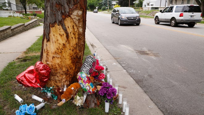Balloons and candles are placed in a memorial to Ronald Martin next to a tree in the 1660 block of Ferry Street Thursday, June 29, 2017, in Lafayette. Martin, 32, crashed his car into the tree early Monday morning and died of his injuries.