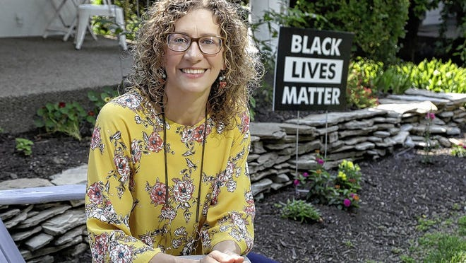 """Grandview Heights City Council member Melanie Houston is the lead sponsor of a resolution to declare racism a public-health crisis and make 2021 a """"Year of Racial Justice Learning"""" in the city. She's pictured June 30 outside her home."""
