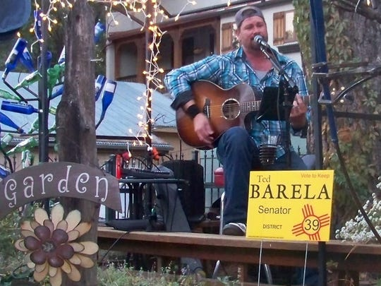 """Guitarist and singer Ryan Martin performs for Sen. Ted Barela's """"Porch Party."""""""