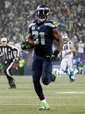 Seahawks safety Kam Chancellor returns an interception 90 yards for a touchdown Saturday against the Panthers.