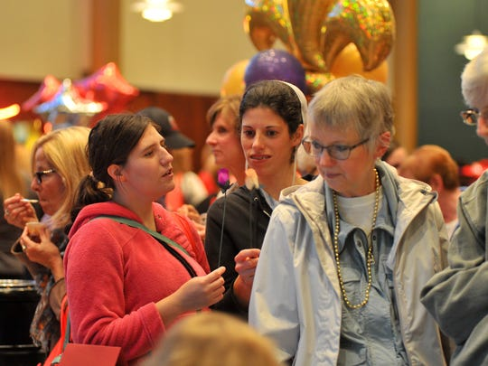 People wait in line for some pastry samples during Thursday night's Taste of Home Cooking School at The Grand in downtown Wausau.