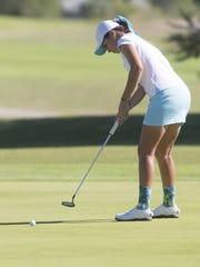Xavier Prep's Madison Kerley putts on the 8th green