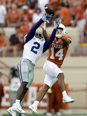 Kansas State defensive back D.J. Reed (2) intercepts a pass intended for Texas wide receiver Lorenzo Joe (14) during the first half of an NCAA college football game, Saturday, Oct. 7, 2017, in Austin.