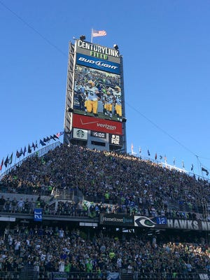 The Green Bay Packers are shown on the video screen as they run onto the field at CenturyLink Field on Sept. 4 for the season opener against the champion Seahawks.