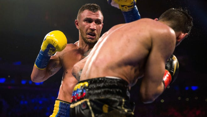 Vasiliy Lomachenko, left, throws a punch at Jorge Linares during his KO victory in May. Lomachenko won despite tearing his labrum in his right shoulder during the bout.