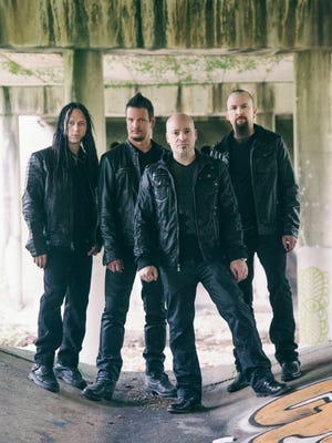The memers of Disturbed — from left, John Moyer, Dan Donegan, David Draiman and Mike Wengren — released 'Immortalized,' their first album in five years, on Aug. 21.