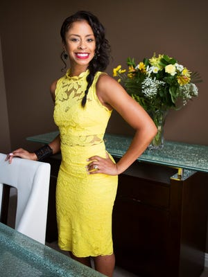 """Stylemaker Chrystal Hawkins inside the dining room of her home. """"I like things that are bold, that you wouldn't just see everyone wearing,"""" Hawkins said. Statement pieces, bold necklaces, shoes and bright colors are staples in Hawkins' style. June 1, 2016"""