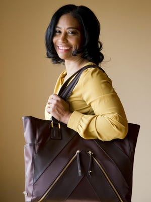 Sherrill Mosee, founder of MinkeeBlue, poses for a photograph with her product, the Madison Tote Bag, in Philadelphia. One of Mosee's totes is selling on QVC.com.