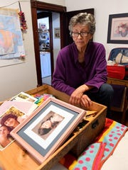 Mary Rose looks through her box of photographs of her daughter Annette at her home in Massachusetts. Her search for answers in Annette's disappearance has taken to several states.