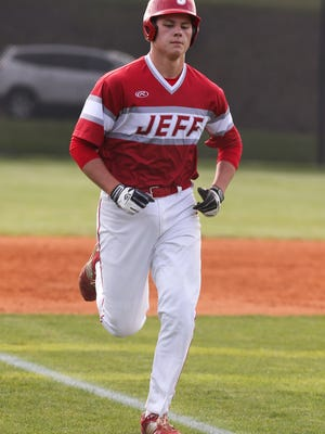 Jeffersonville's Ethan English (32) runs the bases after hitting a 2-run homerun against New Albany at Mt. Tabor Field.  May 10, 2017