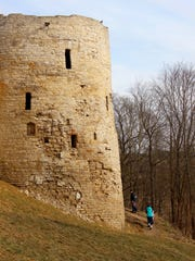People explore around one of the towers at Izborsk, built from limestone quarried locally.