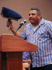 Eddie Flores makes comments while holding a broom to illustrate the point that it would be impossible to use a broom in place of a leaf blower at the Palm Springs City Council meeting, Wednesday, July 19, 2017.