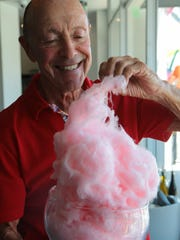 Jerry Keller tastes some of Acqua's signature cotton candy, August 9, 2017.