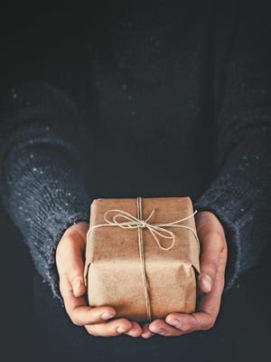 Giving to others during the holidays can bring you happiness.
