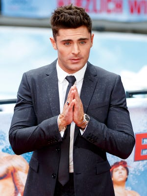 Zac Efron went for a tousled look during a photocall for 'Baywatch' in Berlin on May 30, 2017.