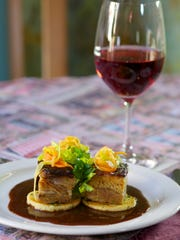 When photographing food, Chris Kridler of Rockledge often includes a glass of wine to add visual interest, like with this photo of braised pork belly taken at Cafe Margaux in Cocoa.