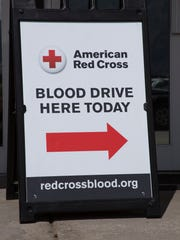 A sign pointing toward a blood drive by the American