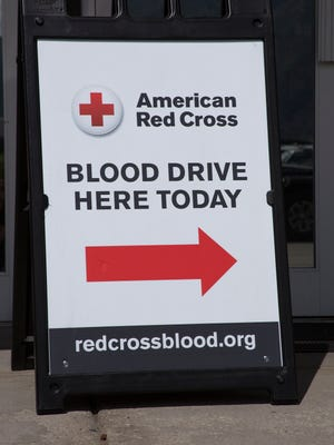 A sign pointing toward a blood drive by the American Red Cross