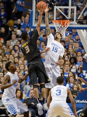 Kentucky's Willie Cauley-Stein defends a shot by Missouri's Johnathan Williams III at Rupp Arena Tuesday Night in Lexington. Kentucky won 86-37. (January 13, 2015)