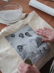 A tote bag has a photo transfer applied to it. Nearly