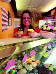 "Owner of Cupcakes in Bloom, Shawnee Berzonski, made it all the way to the finals on the popular TV show, ""Cupcake Wars."""