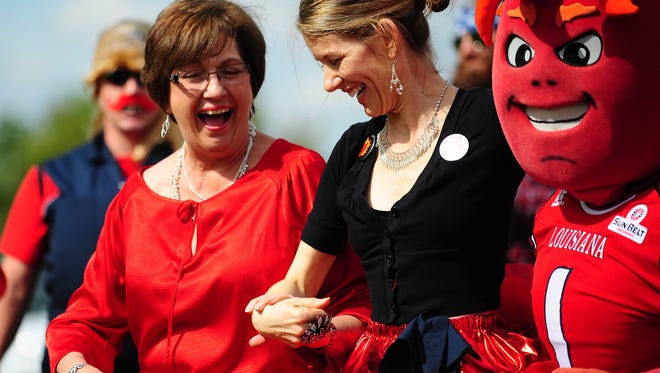 Advertiser File PhotoFormer Gov. Kathleen Blanco, Kathy Pooler, and UL mascot Cayenne dance in a skit as part of the UL Homecoming Paint the Town Red contest during Homecoming 2013. Former Louisiana Governor Kathleen Blanco, Kathy Pooler, and the UL mascot Cayenne dance in a skit as part of the UL Homecoming Paint the Town Red contest at Cox Communicaitons in Lafayette, LA, Tuesday, Oct. 29, 2013. Paul Kieu, The Daily Advertiser