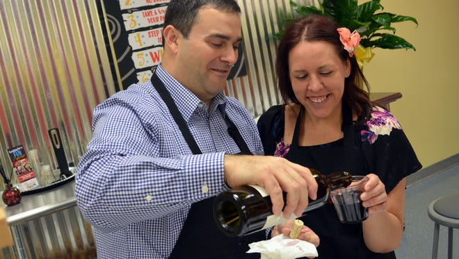 Paul Landry of Brandon and Bethany Adams of Petal enjoy a glass of wine during their date night at Painting with a Twist.