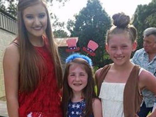 Anna Neal, Lily Herrick, Paige Timmons at Sarepta July 4 celebration.