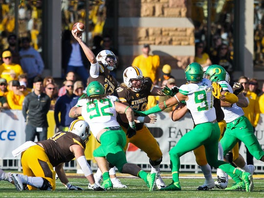 Wyoming quarterback Josh Allen (17) makes a throw during the first half of an NCAA college football game against Oregon in Laramie, Wyo., Saturday, Sept.16, 2017. (AP Photo/Shannon Broderick)