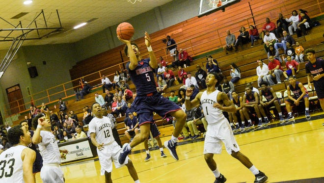 Dwaughn Thomas takes the ball to the basket Friday night against New Iberia High.