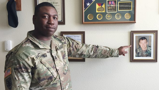 Capt. Raymond Colston, with the 22nd Chemical, Biological, Radiological and Nuclear Battalion, shows the memorial to fallen hero Sgt. 1st Class Kevin P. Jessen.