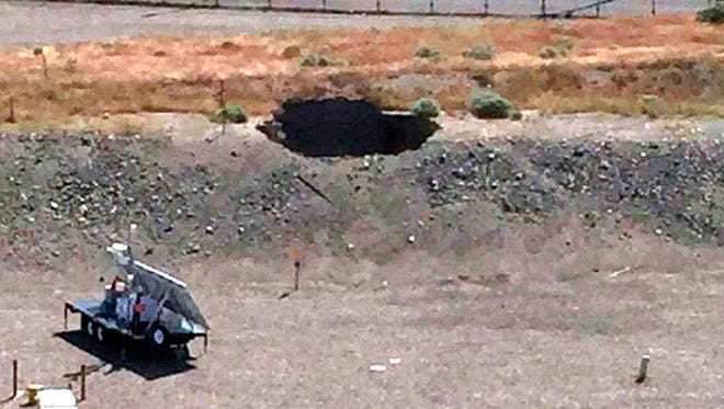This image provided by the U.S. Department of Energy shows a 20-foot by 20-foot hole in the roof of a storage tunnel at the Hanford Nuclear Reservation. An emergency was declared Tuesday after the partial collapse of the tunnel that contains rail cars full of radioactive waste.