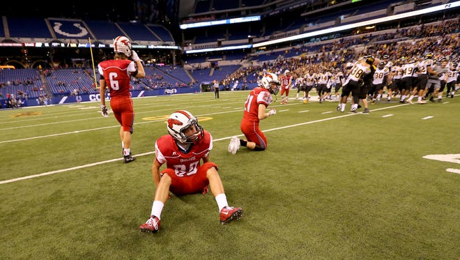 New Palestine's Brady Walden (80) looks up to the scoreboard after the Dragons' loss to Fort Wayne Snider at Lucas Oil Stadium on Nov. 27, 2015.