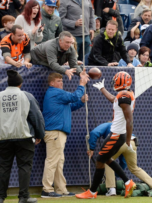 Cincinnati Bengals wide receiver A.J. Green tosses the ball to a fan after he scored a touchdown on a 70-yard pass against the Tennessee Titans in the second half of an NFL football game Sunday, Nov. 12, 2017, in Nashville, Tenn. (AP Photo/Mark Zaleski)