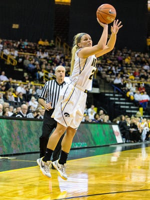 Iowa's Melissa Dixon (21) fires a three-point shot versus Purdue during the first half of play at Carver-Hawkeye Arena in Iowa City on Sunday, January 11, 2015. The Hawkeyes beat the Boilermakers (9-7, 2-3) 73-59 to improve to 12-3 overall and 3-1 in conference play.