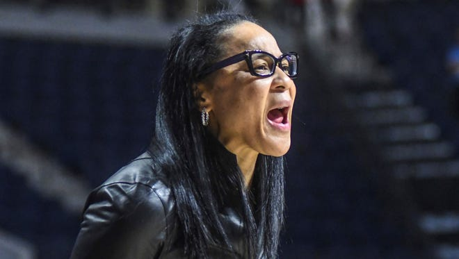 South Carolina coach Dawn Staley talks to her players in the first half of an NCAA college basketball game against South Carolina in Oxford, Miss., Thursday, Jan. 4, 2018. (Bruce Newman/The Oxford Eagle via AP)
