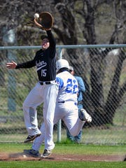 Fabian Vazquez of Windthorst beats the throw as Archer City first baseman Tyler Beggs (15) jumps to make the catch Tuesday afternoon.