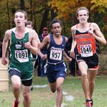 Novi's Joost Plaetinck (left), Franklin's Tony Floyd (middle) and Northville's Conor Naughton jockey for position up front in Thursday's Kensington Conference meet.