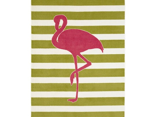 In this photo provided by Overstock.com, a pink flamingo struts across a preppy striped rug shown here from Overstock.