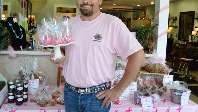 Mark Rodolico, owner of Mark's at the Pointe, showcases some of the treats during last year's annual bake sale to benefit Friends After Diagnosis.