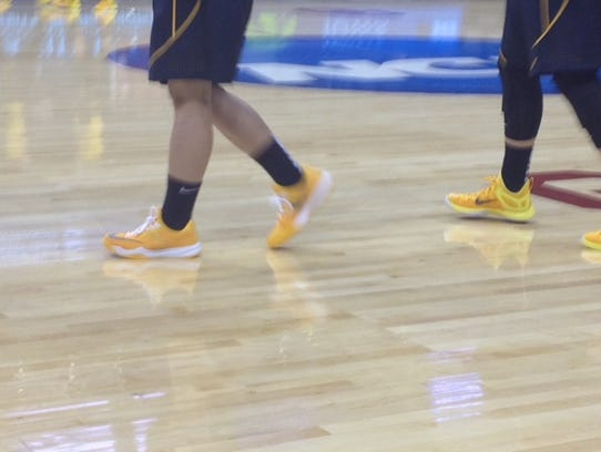 Melissa Dixon's shoes (left) are noticeably a different