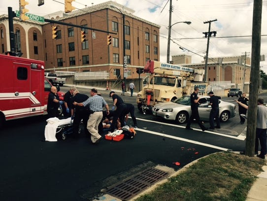 A motorcycle was lodged under a commercial truck Monday