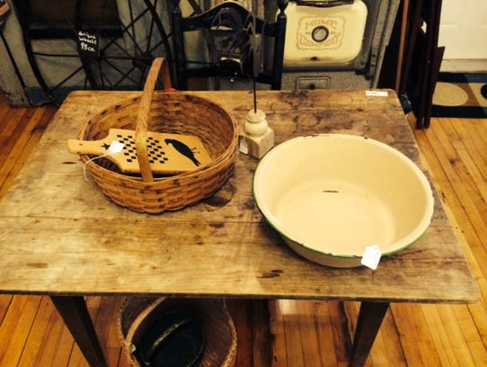 A vintage table sits on the hardwood floors at Cranberry
