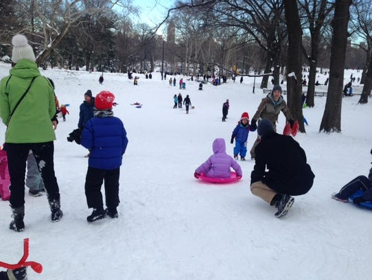 Families enjoy sledding in New York's Central Park