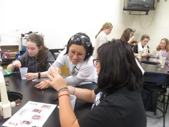 "ExxonMobil scientists visit Woodglen School. The ""hands-on"""