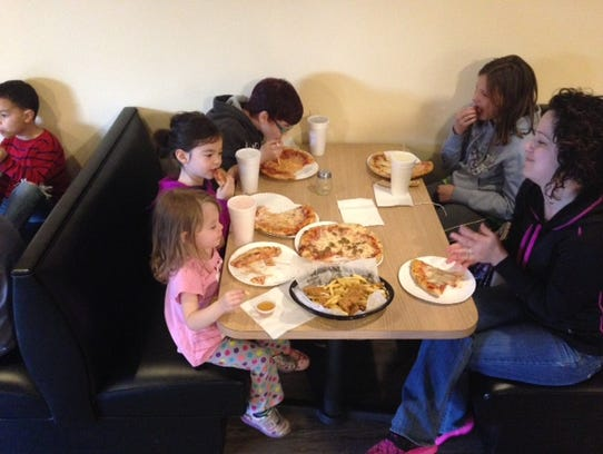 A group sits at Divino Pizzeria & Grille in Hanover