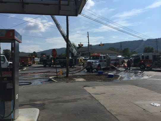 Firefighters evacuated a gas station located nearby