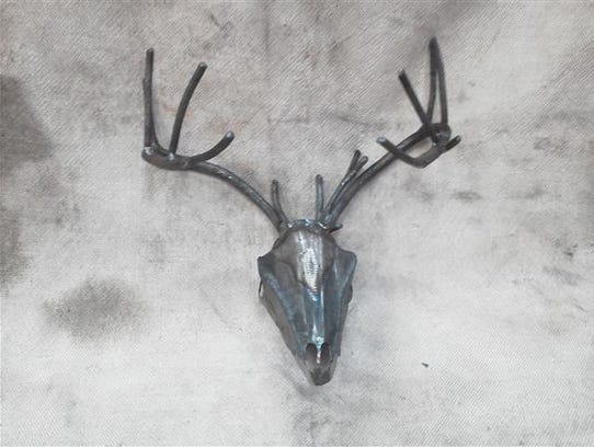 Leonard's sculpted deer's head features in downtown
